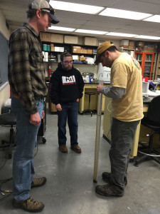 (left) Jacob Lemon, PATU Eastern Shale Gas Monitoring Coordinator, teaching workshop attendee's how to use a Secchi Tube to measure water turbidity.